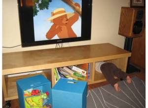 kid stuck under tv