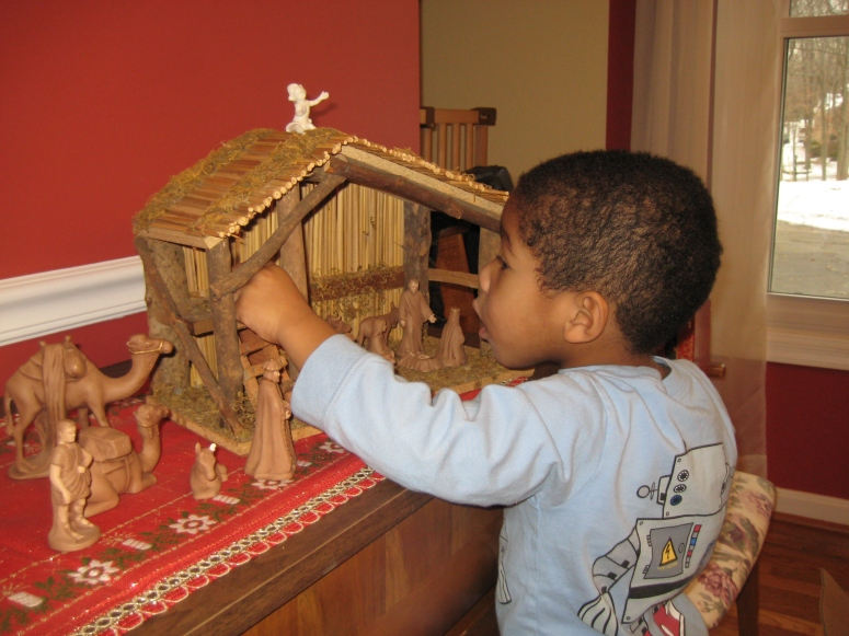 Photo IS Reality: My son plays with the nativity that his Great-Great-Grandma made by hand, and learns about the birth of Jesus. Win.
