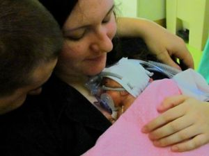 This is the first time Dee was able to hold her own baby. She had to wait two agonizing weeks for this touch.