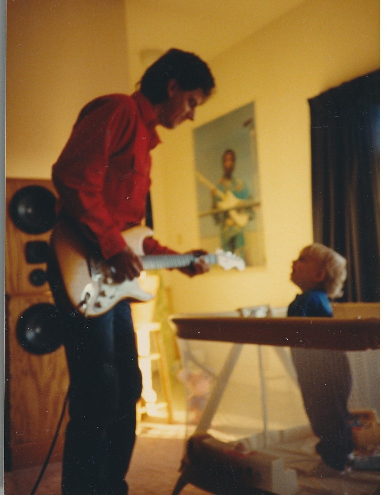 My dad and my baby brother, circa 1989, with Jimi between them.