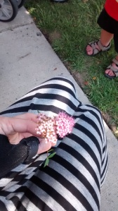 My ever-present wrist brace helps me hold this heavy flower (the first flower my kid ever gave me!)